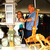 Debbie Blank | The Herald-Tribune<br /> Dale Foster (right), Guilford, of Little Torch Woodworking, shows Charm Seright, Lake Santee, a birdhouse. He also makes rocking horses, sleds, cocktail tables and even small boats.