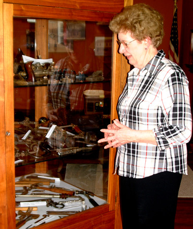 Debbie Blank | The Herald-Tribune<br /> Batesville Area Historical Society volunteer Arlene Wachsmann, Batesville, shows off some of the many woodworking tools Joe Greiwe has collected. During the fest, the group sponsored a wood identification contest. The George Street center's exhibit on the subject closed May 7.