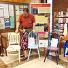 Debbie Blank | The Herald-Tribune<br /> Batesville Rotary Club members (from left) Marie Dausch and Mike Kruse, his granddaughter Monroe Phillips, 6, Indianapolis and Batesville High School Interact Club adviser Lisa Gausman admire hand-painted contributions for a Chairs for Charity silent auction at Sawdust Days first event, a Friday night library concert. The club, which stands for International Action, is a youth organization sponsored by Rotary International.