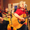 Debbie Blank | The Herald-Tribune<br /> Cincinnati-based Ma Crow and the Lady Slippers -- Margie Drees (from left) on fiddle, Vicki Abbott on  bass, Ma Crow on guitar and Trina Emig  on banjo and mandolin -- dazzled the crowd with twangy storytelling bluegrass songs.