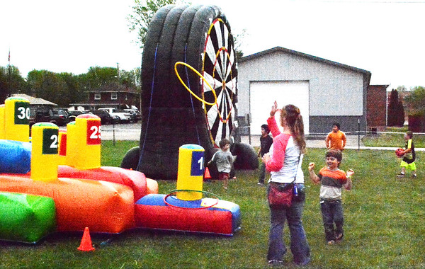 Debbie Blank   The Herald-Tribune<br /> Children and teens had fun at a variety of inflatables spread throughout Sunman Community Park Saturday, May 5.