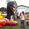 Debbie Blank | The Herald-Tribune<br /> Children and teens had fun at a variety of inflatables spread throughout Sunman Community Park Saturday, May 5.