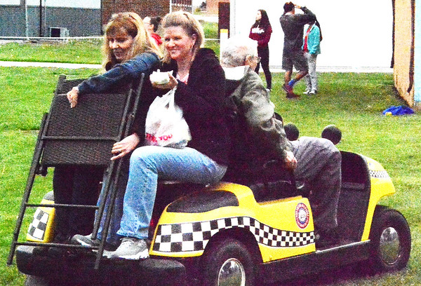 Debbie Blank   The Herald-Tribune<br /> A golf cart was an efficient way to get senior citizens and equipment around the park.