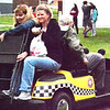 Debbie Blank | The Herald-Tribune<br /> A golf cart was an efficient way to get senior citizens and equipment around the park.