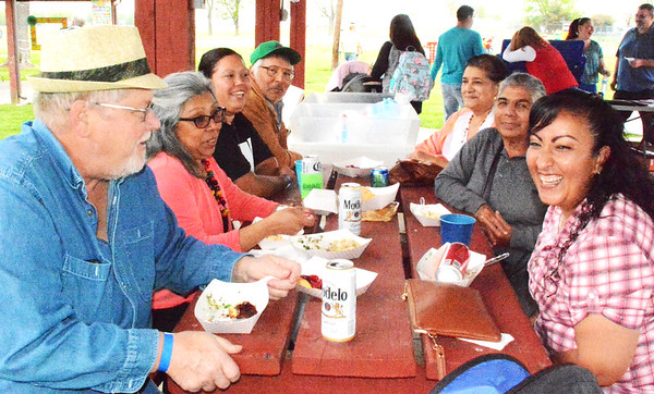 Debbie Blank | The Herald-Tribune<br /> Local residents mingled with visitors while dining. At one picnic table were (clockwise from left) Fred and Gladys Dall, Morris; Maria Nunez, Sunman; Salvador and Maria Blanco, Batesville; Socorro Gonzalez, Jalisco, Mexico; and Lidia Hernandez, Guadalajara, Mexico.