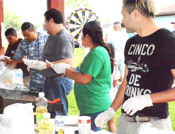Debbie Blank | The Herald-Tribune<br /> Serving up tacos, carnitas, tamales, cheese nachos and chips with three blends of salsa were (from left) Victor Cisneros, Sunman; Ray Aunec, Batesville; Hector Meneses, Batesville; Nydia Hernandez, Sunman; and her brother Javier Hernandez, Batesville. Not pictured is Ricardo Camarena, Batesville. Sunman Community Park Board Vice President Carla Hacker marveled at how much fun committee members had planning the Cinco de Mayo Festival and Celebration May 5.
