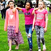 Debbie Blank | The Herald-Tribune<br /> Sunman Elementary School students (from left) Allie Harris, Karol Rodriguez and Kenzie Acheson are the same age, 11, and enjoyed the same treat, nachos, at the festival.