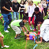 Debbie Blank | The Herald-Tribune<br /> It just took a boy a few blindfolded swings with a bat at a moving piñata for it to break open. Children scrambled to pick up candy at the Cinco de Mayo Festival and Celebration May 5 at Sunman Community Park. Other attractions were a Home Run Derby, children and teen inflatables, a photo booth and mix of Mexican and American music. Proceeds went to improve the park.