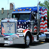 Diane Raver | The Herald-Tribune<br /> ROUNDING OUT THE PARADE, this semi has a special message for veterans, thanking them for their service.