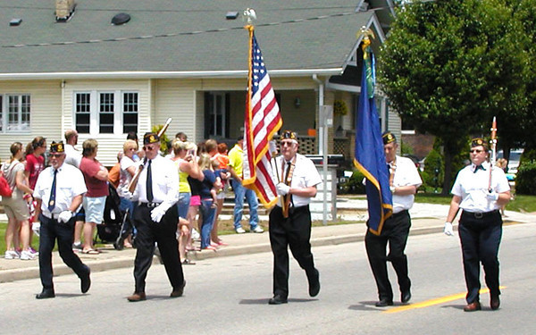 Diane Raver | The Herald-Tribune<br /> SUNMAN AMERICAN LEGION members marched along the parade route, proudly displaying the flags.