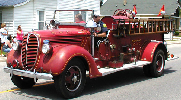 Diane Raver | The Herald-Tribune<br /> SUNMAN FIRE CHIEF Bill Craig drives one of the many fire trucks that was in the parade.