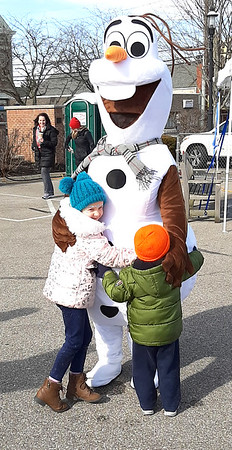 """Olaf received many hugs when he showed up at the downtown event. When one youngster saw him coming, he excitedly shouted, """"Dad, look, it's Olaf!"""""""