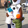 "Olaf received many hugs when he showed up at the downtown event. When one youngster saw him coming, he excitedly shouted, ""Dad, look, it's Olaf!"""