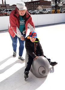 Chandler Hotchkiss, 4, Batesville, gets a push from his mom, Kelsey.