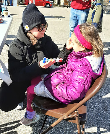 Kerra Bass gets her face painted by Hayley Springer.