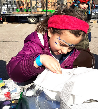 After getting her face painted, Kerra Bass, 5, chooses a toy from the bag.