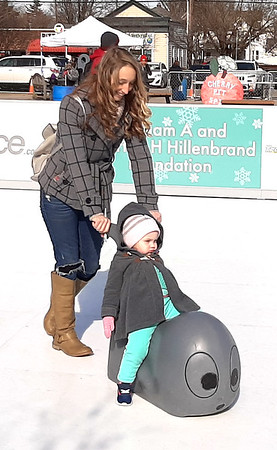 This young lady just relaxed as she rode around the skating rink.