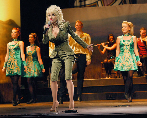 Photo Earl Neikirk/Bristol Herald Courier  Dolly Parton sings with the cast of The show Rhythum of the Dance is playing at the Celebrity Theatre at Dollywood.