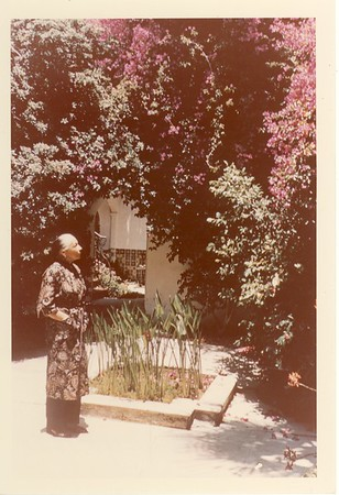 Marta Feuchtwanger near a pond at her Pacific Palisades home, 1958
