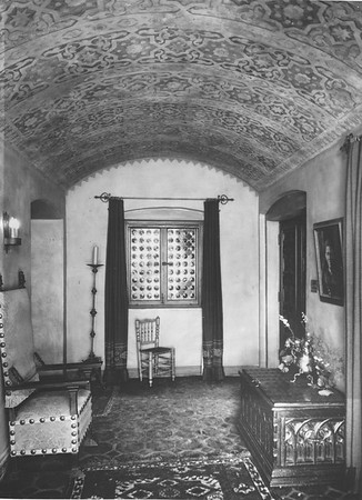 Hallway with window and chair at end, hall seat to one side, trunk to the other, Villa Aurora