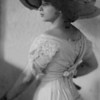 Marta Feuchtwanger as a young woman, late teens-early 20s, poses in a formal photograph, ca. 1905-1915