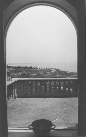 View through the arched front terrace window, Villa Aurora, bowl in foreground, 1947