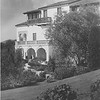 Villa Aurora exterior with grassy slope in foreground, 1930
