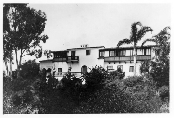 Villa Aurora in center and center-left of photo, somewhat in the distance, large tree on left hand side of frame