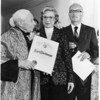 Marta Feuchtwanger holds a recognition given to her by the City of Los Angeles, 1976