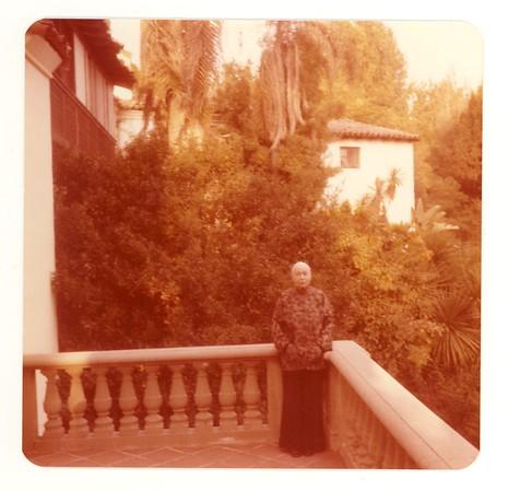 Color photo of Marta Feuchtwanger on balcony of Villa Aurora, 1977