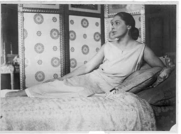 Marta Feuchtwanger poses on a chaise lounge as a young woman, 1921
