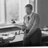 Feuchtwanger resting on a desk in his study in Berlin, 1932