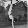 Marta Feuchtwanger doing a handstand on a lawn in Berlin, 1932