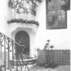 Section of staircase, arched window, and meeting point of two walls in courtyard, Villa Aurora