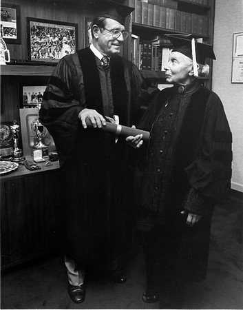 Marta Feuchtwanger receving her diploma from USC President Hubbard, 1980