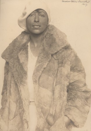 Marta Feuchtwanger as a young woman wearing a fur coat, 1927