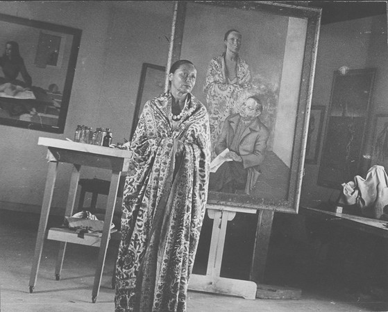 Marta Feuchtwanger in front of painting by Ernest von Leyden, 1945