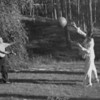 Lion and Marta Feuchtwanger playing catch, Berlin, 1932