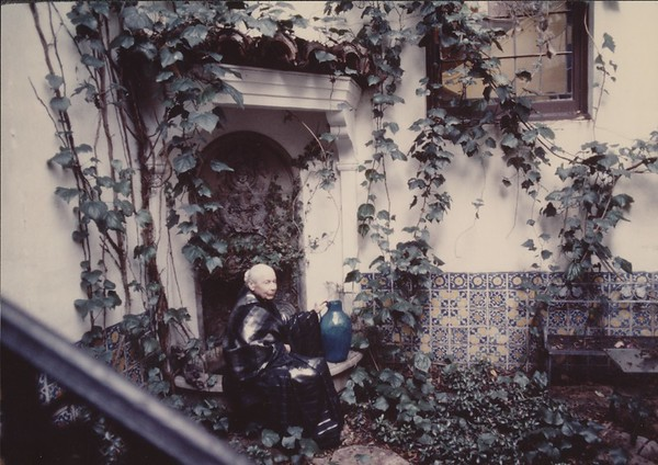 Marta Feuchtwanger sitting in the garden of her Pacific Palisades home, ca. 1970-1980