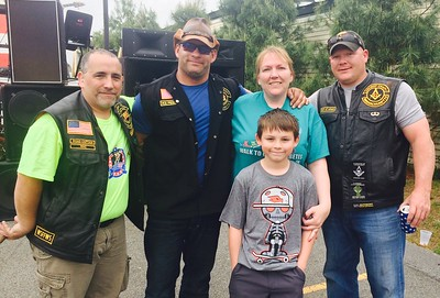 From left, Sean McNamara, NASCAR Dave, both of Billerica, Gerry Comerford with her son Natty, in front, of Chelmsford, and Billy Connors of Billerica