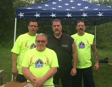 From left, Ed DiNitto of Bedford, founder George Farrington Sr. of Lowell, Scott Norman and founder Mike Bradford, both of Billerica