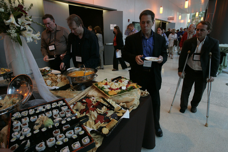 A beautiful reception is provided mid-tour at the Next-Generation Visualization and Networking Facilities, Calit2, UCSD: [L-R] Mark Atkins, Steve Broback, Jim Marggraff, and Don Helfgott