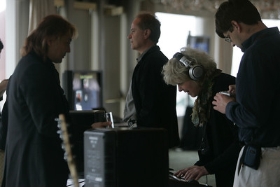 """""""Meet the FiReStarters and Spotlight Company"""": Victor Wong (L), Co-Founder and Chair, Open Labs Inc., demonstrates Open Labs' music technology to John Petote, Jean Wooldridge, and Tom Krazit"""