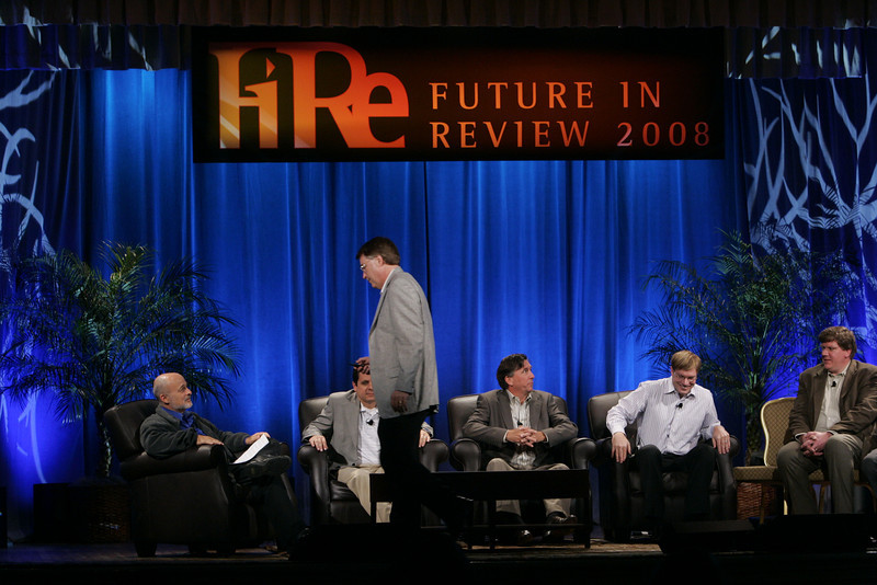 "CTO Design Challenge: ""And the Solution Is--"": (Standing) Host Larry Smarr, (L-R) moderator David Brin, Brian Higbee, Kevin Walter, Kelly Millsaps, and Ty Carlson"