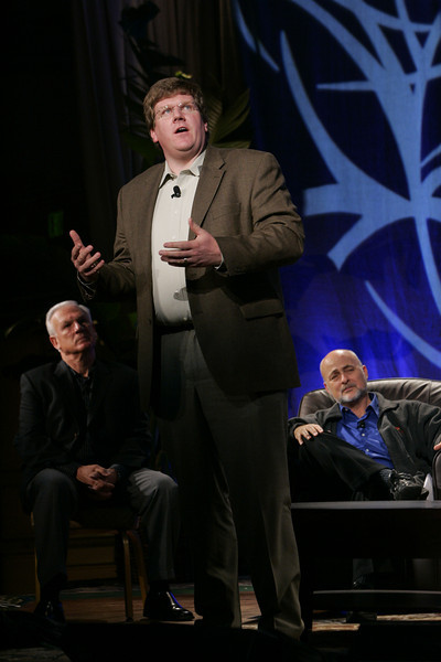 """CTO Design Challenge: """"And the Solution Is--"""": (L-R) Ron Roberts, Supervisor, San Diego County Board of Supervisors; Ty Carlson (presenting), Architect, SiArch, Microsoft; and moderator David Brin, author and physicist"""