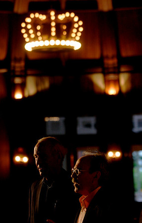 """Bill Budinger (L), The Rodel Foundations; and Bill Janeway, Warburg Pincus, appear to share the crown: a chandelier designed by """"Wizard of Oz"""" author Frank Baum"""
