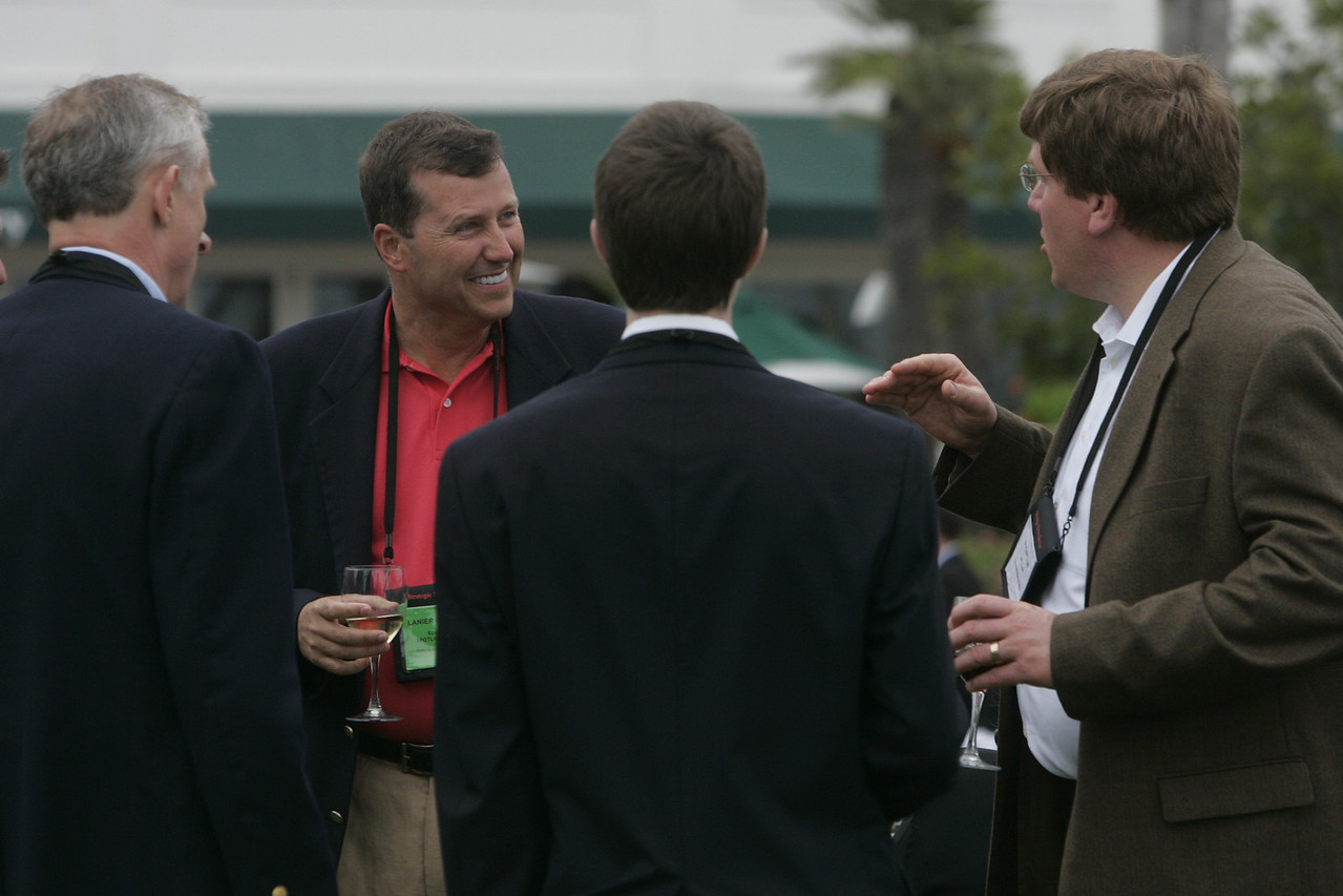 Lanier Davenport (in coral polo) of EcoVerdance laughs at a point made by Microsoft's Ty Carlson