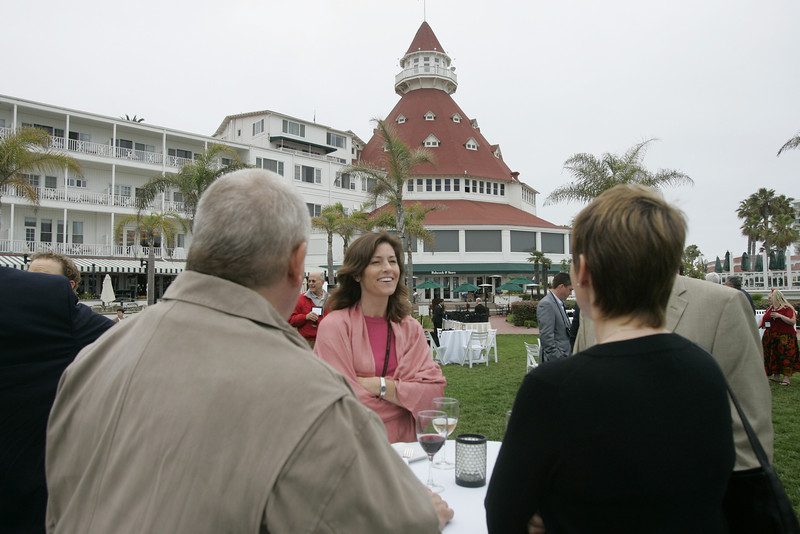 A smiling Chenoa Farnsworth, Co-Founder and Partner of Kolohala Holdings; Grand Ballroom tower in the background