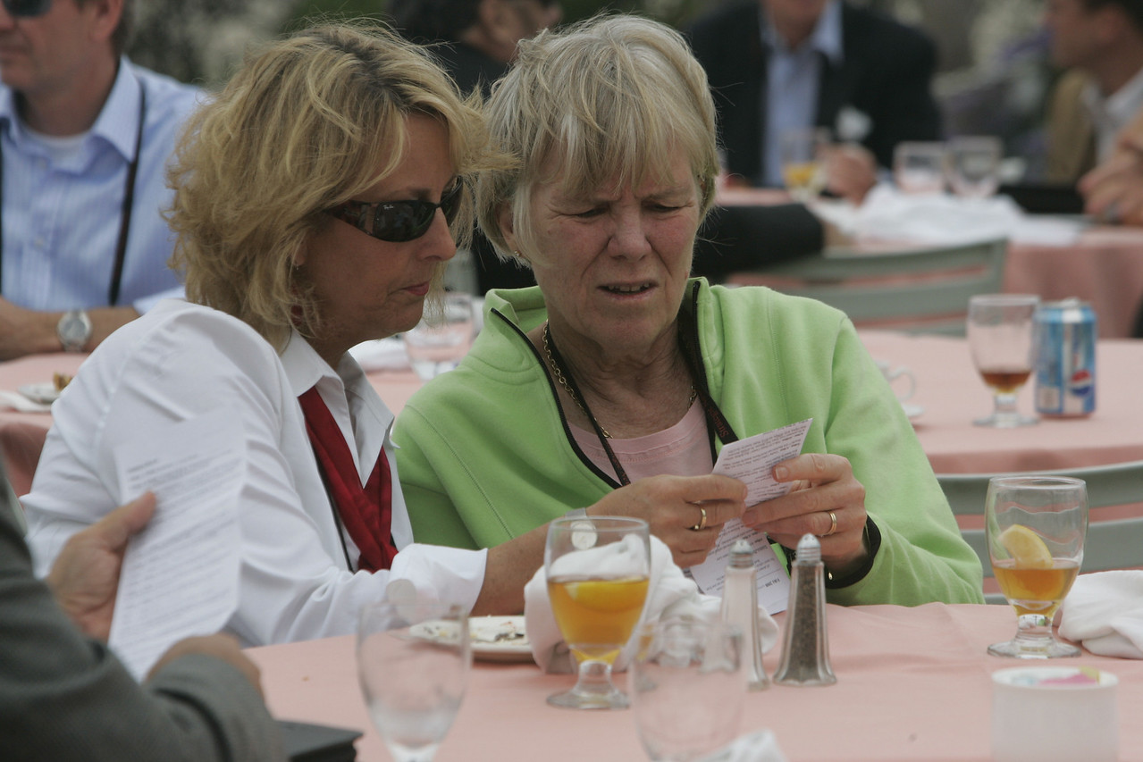 Lunch on the Windsor Lawn: SNS Programs Director Sharon Anderson-Morris (L) and longtime SNS friend Suzie Harned decipher  the day's mini-agenda