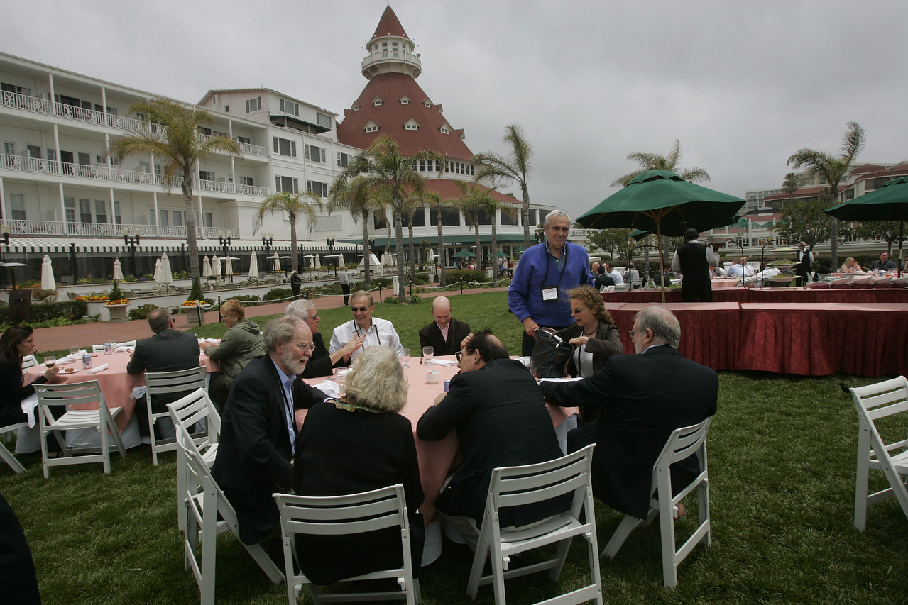 Lunch on the Windsor Lawn: (foreground, L-R) James McCarthy, Jean Wooldridge, William Haseltine, Richard Carson, Cynthia, Gary Ritner (standing), Max Christoff, and Hugh Bradlow